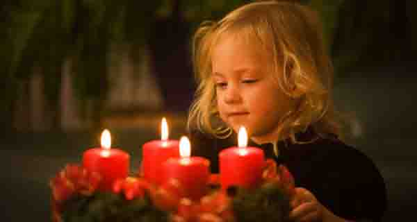 Girl enthralled by candles