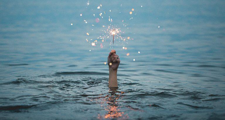 Hand holding fireworks