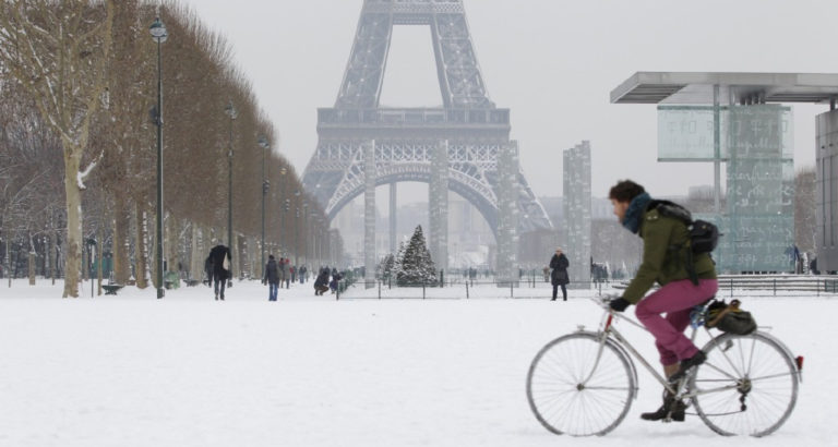 Biker in Paris in the snow